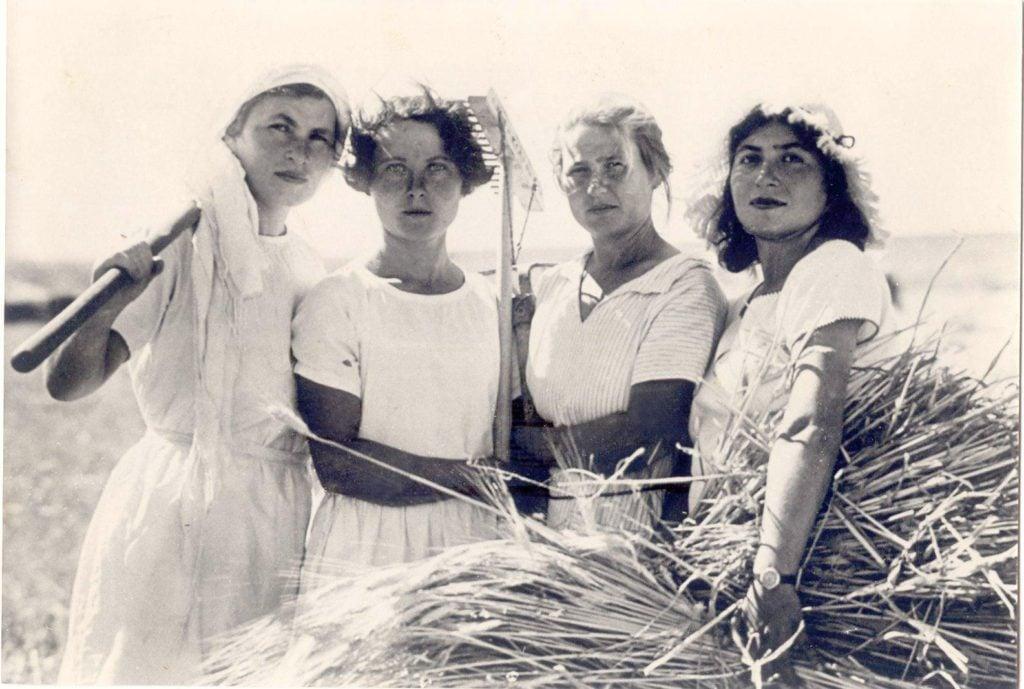 Women work the land of the Kibbutz.