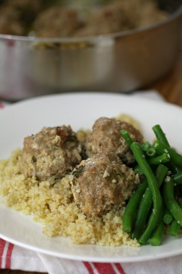 This is an easy turkey or chicken meatball recipe in cilantro, lemon, and garlic sauce. Serve over rice, quinoa, or bulgur.