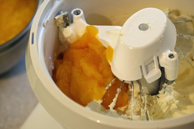 Adding fresh pumpkin puree to mixer.