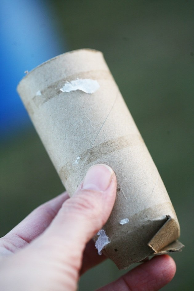 Tall toilet paper roll with bottom.