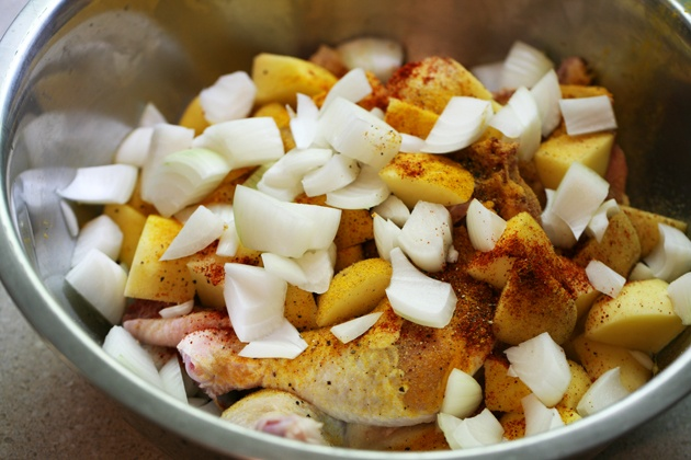 Super easy roasted chicken with potatoes and onions. It takes just a couple of minutes to put this together!