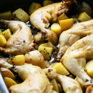 Oven Roasted Chicken With Potatoes and Onions