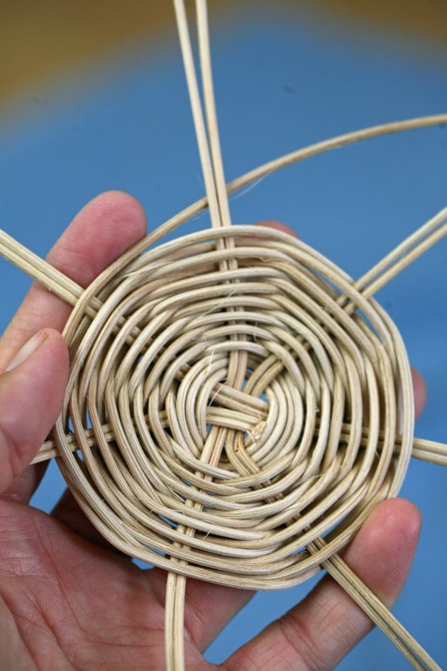 Weaving a round basket.