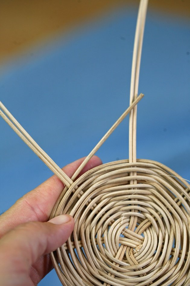 Starting to band a handmade basket.
