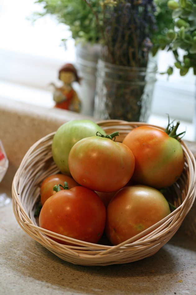 Tomatoes in a handmade reed basket