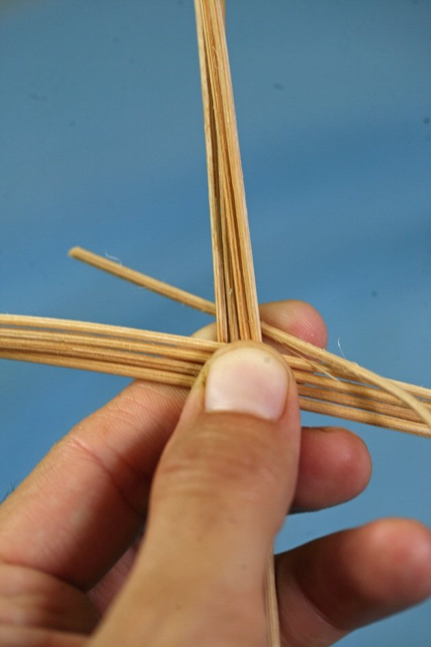 Starting to weave a simple basket.