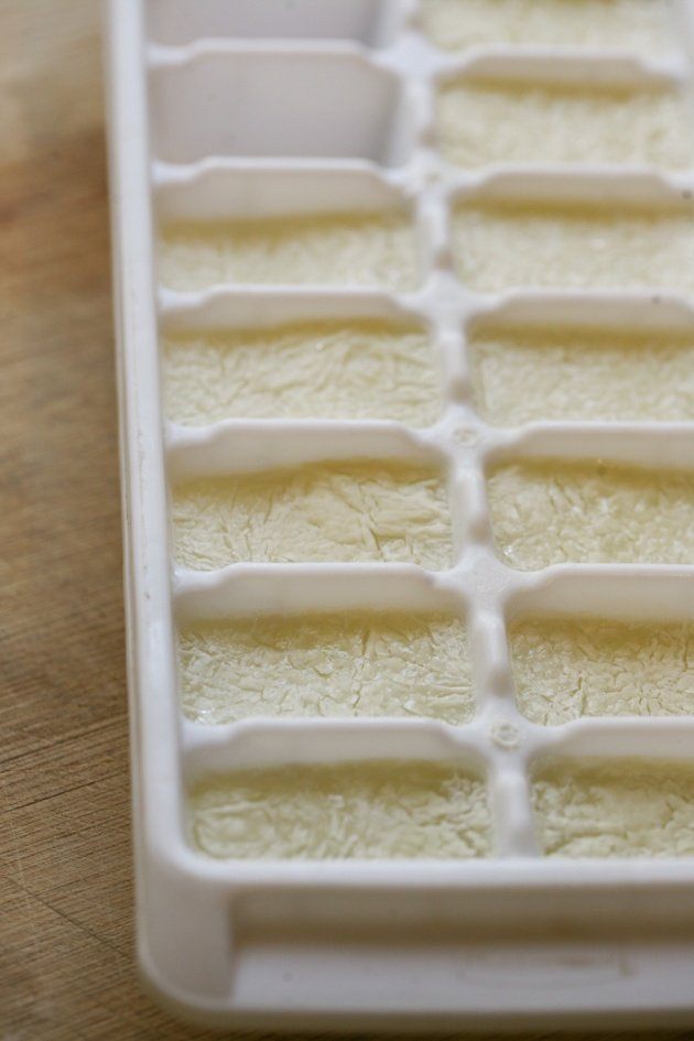 Freezing goat milk in a tray.