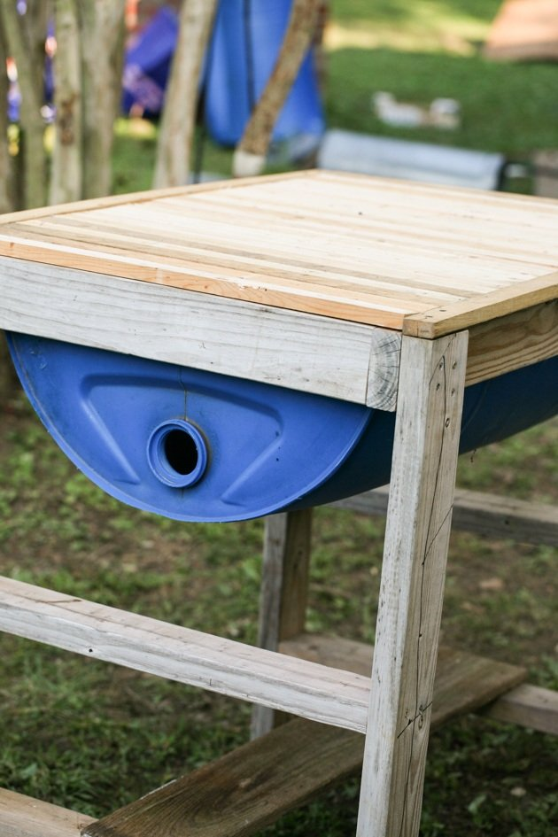 DIY top bar hive from a barrel. A step by step picture tutorial on how we made our top bar bee hive. It is a fairly easy project and very inexpensive. Can be completed in just a few hours.