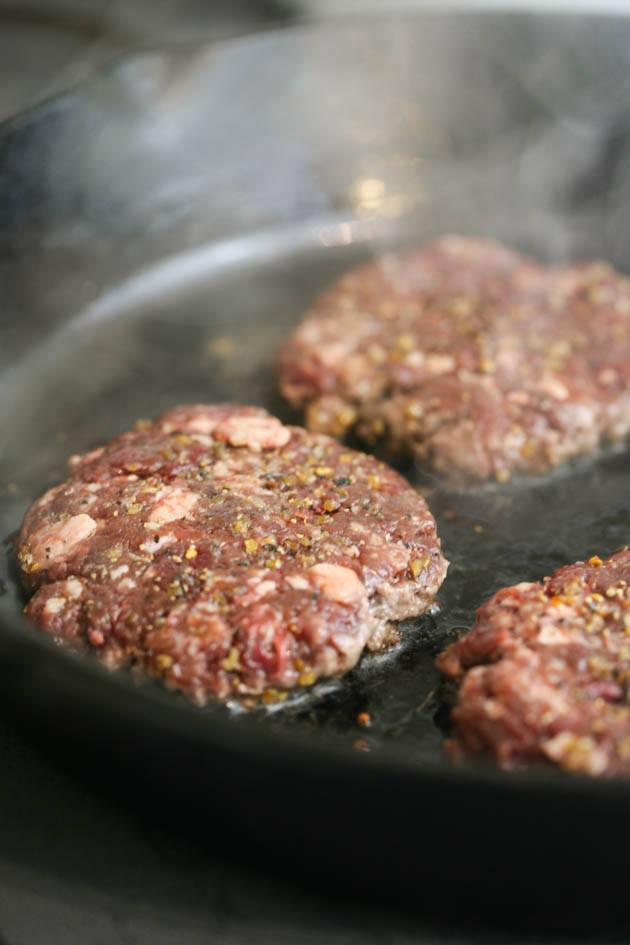 These ground venison burgers are divine! The best hunters food. The process is simple and a secret ingredient takes this burger to the next level! #groundvenisonburgers #venisonburgers #homemadeburgers #burgerrecipe #hamburgerrecipe #huntersfood #venisonrecipes