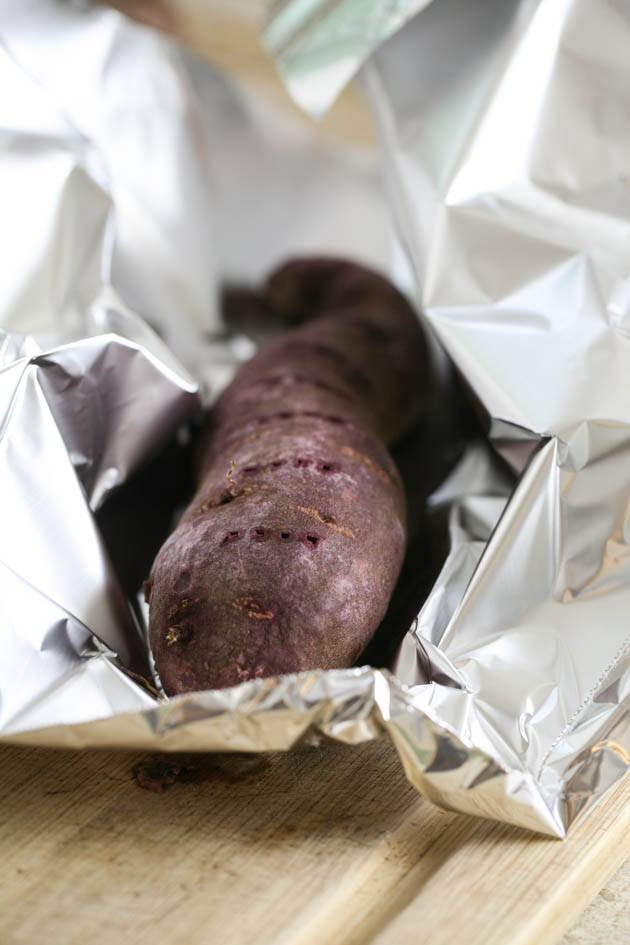 Wrapping the purple sweet potato in tin foil.