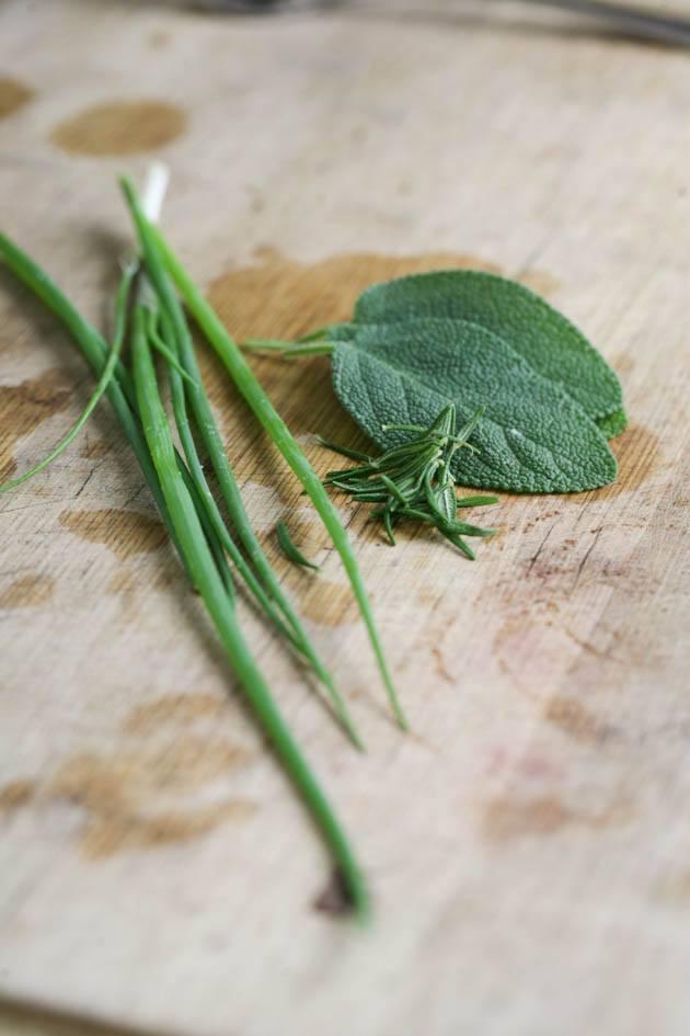 Green onion, rosemary, and sage to season the potato.