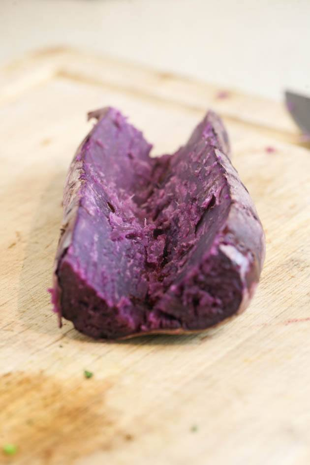 Slicing the baked purple sweet potato.