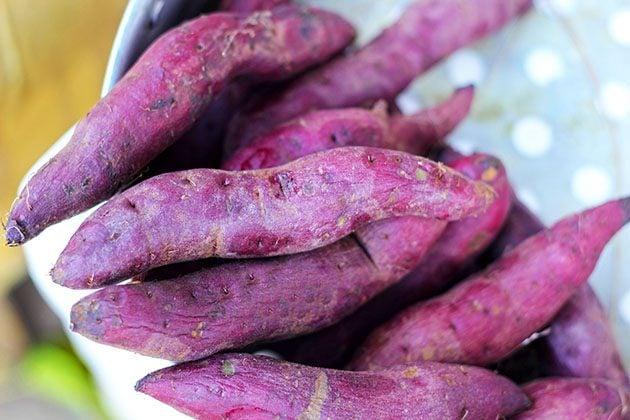 A pile of purple sweet potatoes.