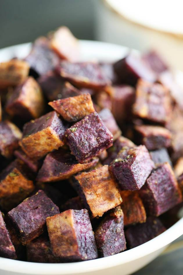 A simple and delicious recipe for roasted purple sweet potatoes. It takes about ten minutes to put together and it's healthy and tasty. #roastedpurplesweetpotatoes #purplesweetpotatoes