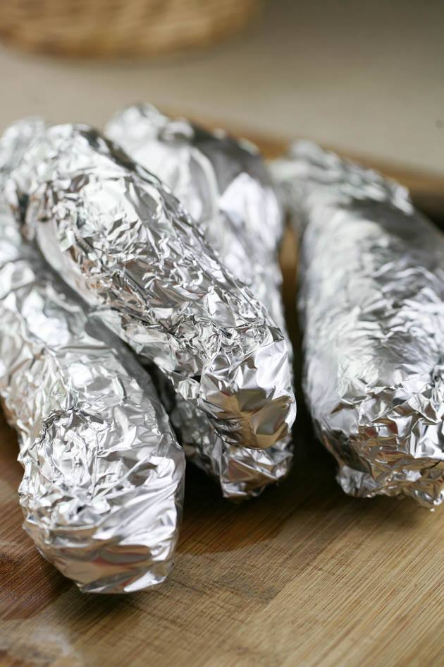 Purple sweet potatoes wrapped in tin foil