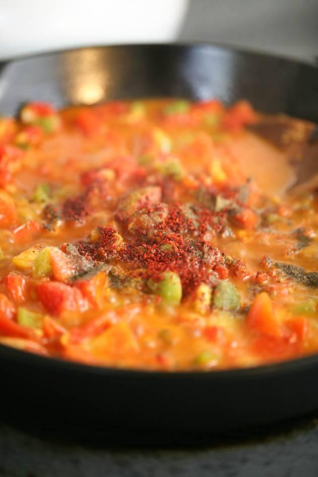 Seasoning the shakshuka sauce