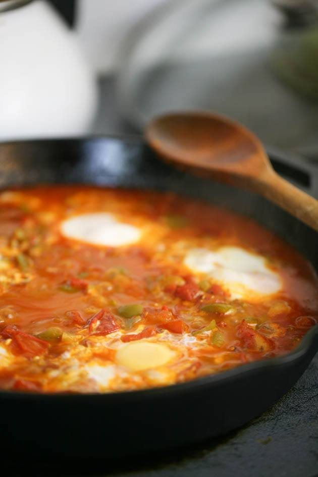 Cooking the eggs in the shakshuka