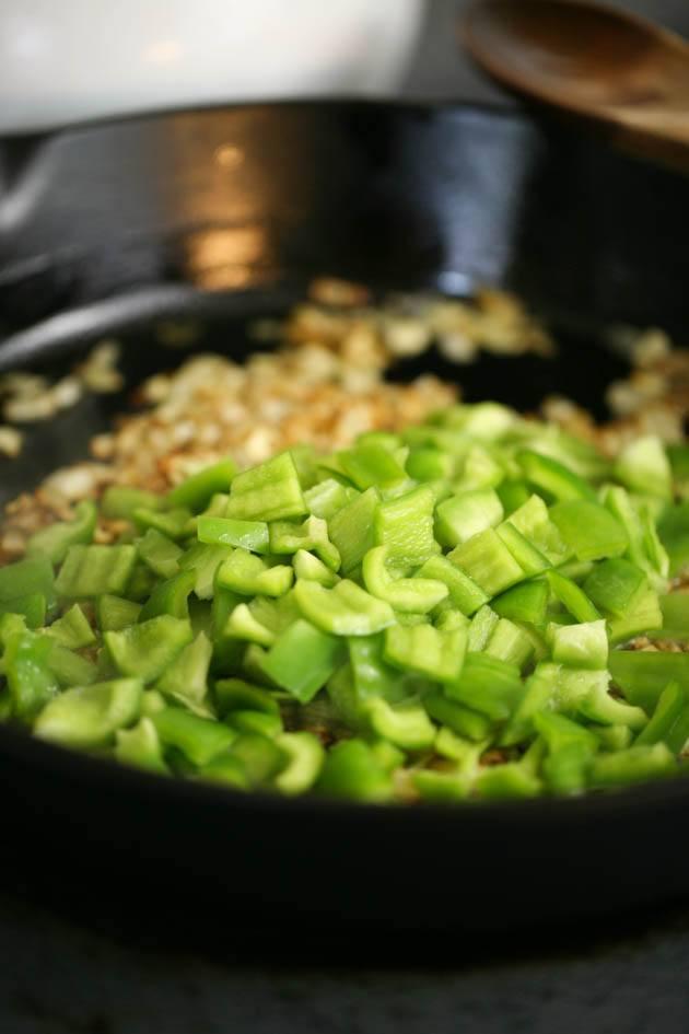 Adding peppers to healthy shakshuka recipe