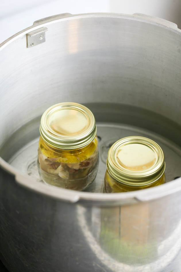 Setting the jars in the pressure canner.