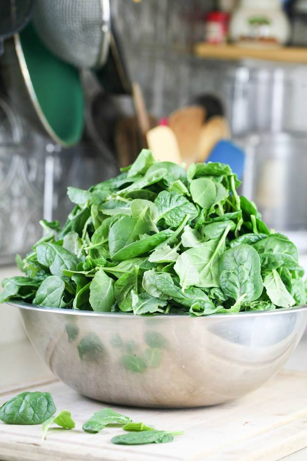 A bowl of fresh spinach.