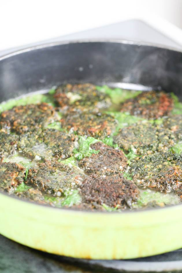 Adding the spinach patties.