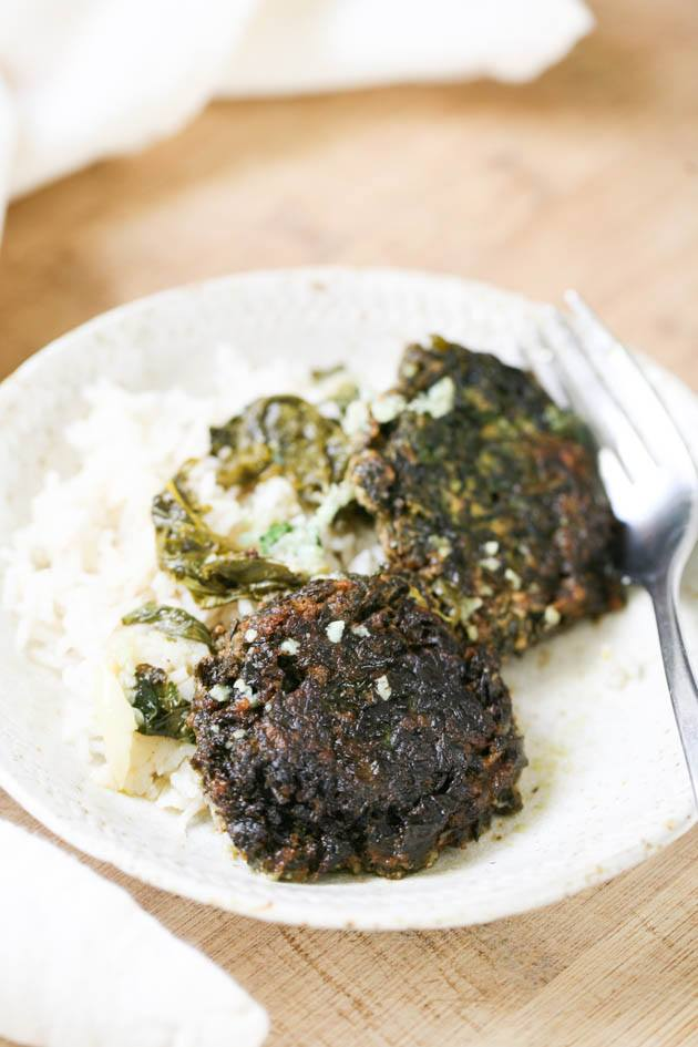 Spinach patties served with rice.