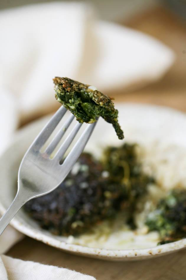 Spinach patties on a fork.