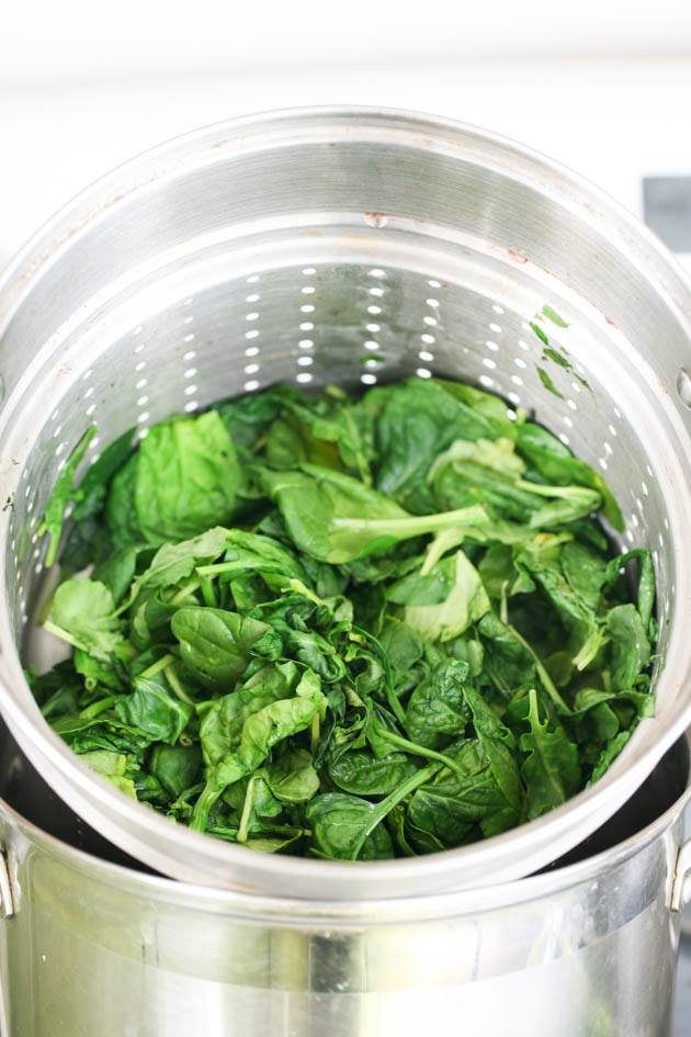 Steaming the spinach.