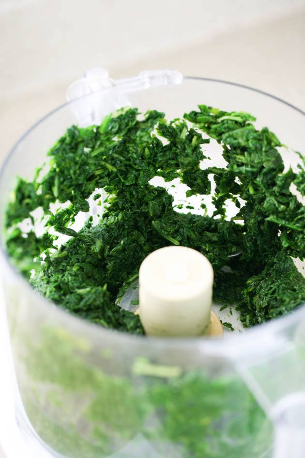 Processing the spinach in the food processor.