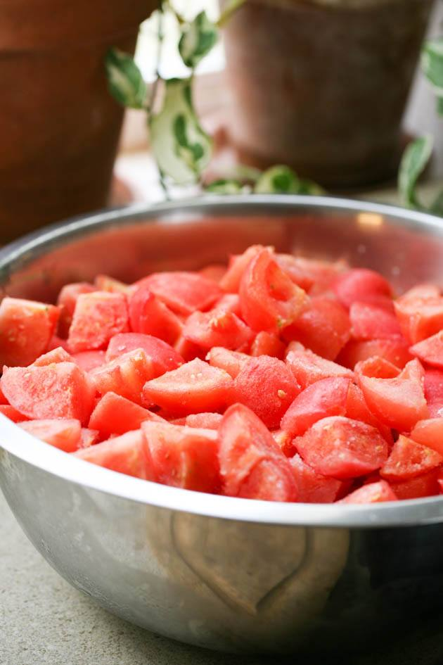 Diced frozen tomatoes in a bowl.