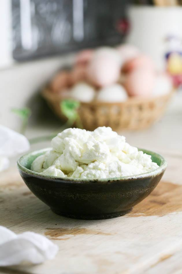 Adding the goat cheese to a bowl.