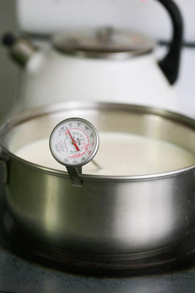 Heating the goat milk.