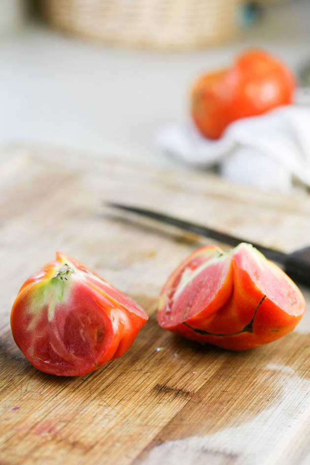 How to freeze tomatoes - cutting the tomato further.