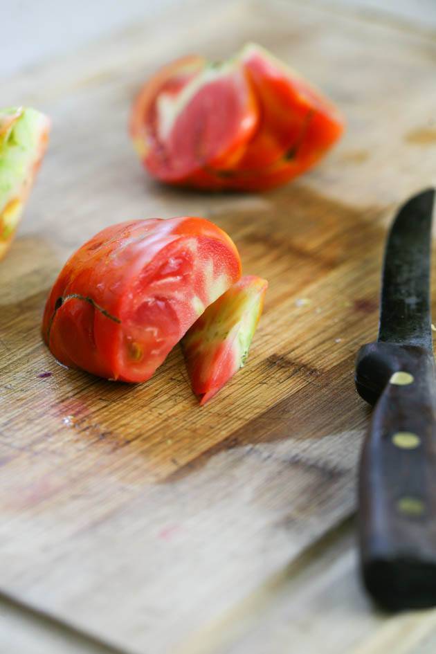 Removing the core of the tomato.