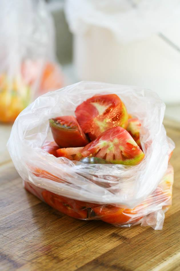 Cut tomatoes in a bag ready for freezing.