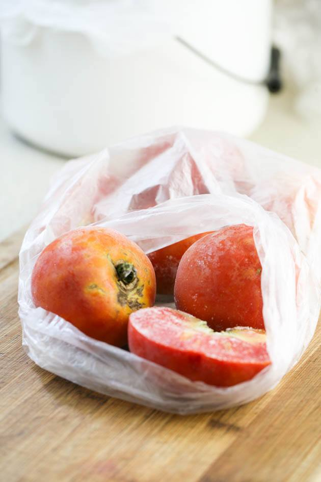 Frozen tomatoes in a bag.