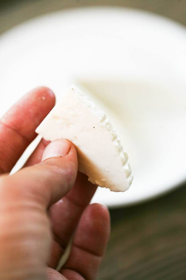 A slice of raw goat milk cheese.