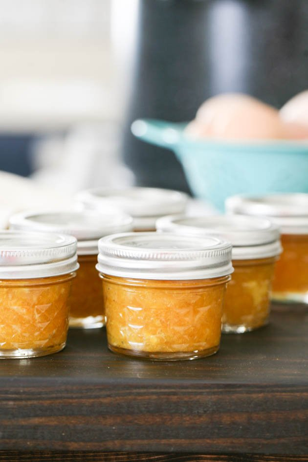 Homemade orange jam ready for storage.