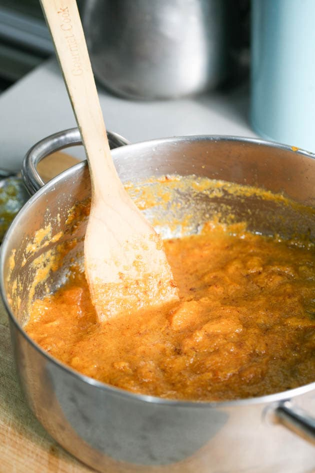 Persimmon jam cooking in a pot.