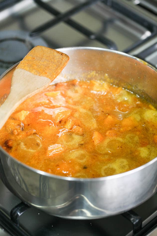 Bringing persimmon jam to a boil.