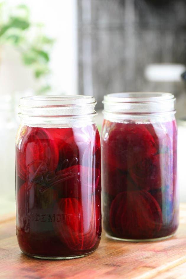 Adding liquid to the jars.