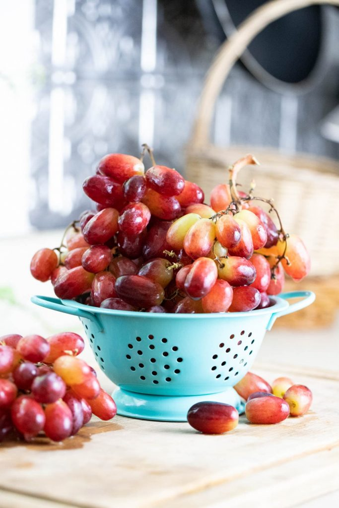 A bowl of seedless red grapes.
