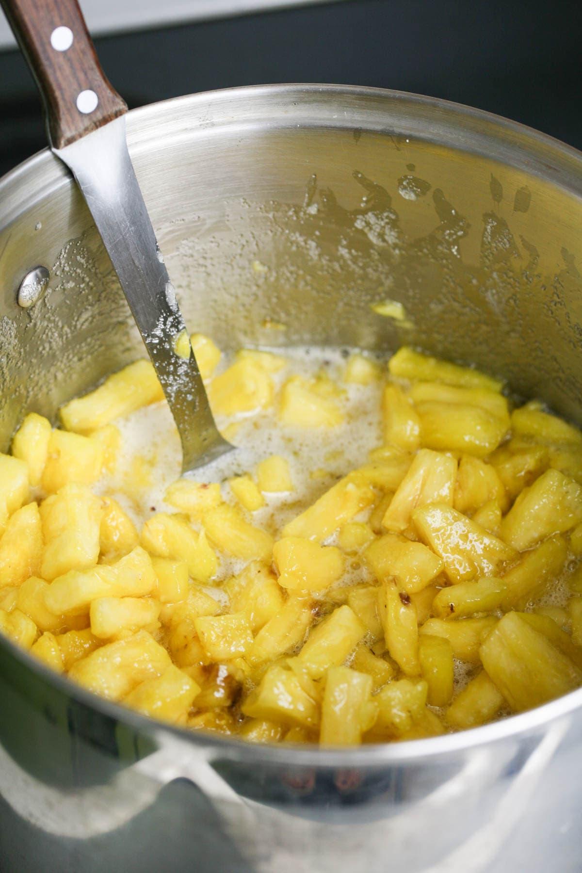 Stirring the jam.