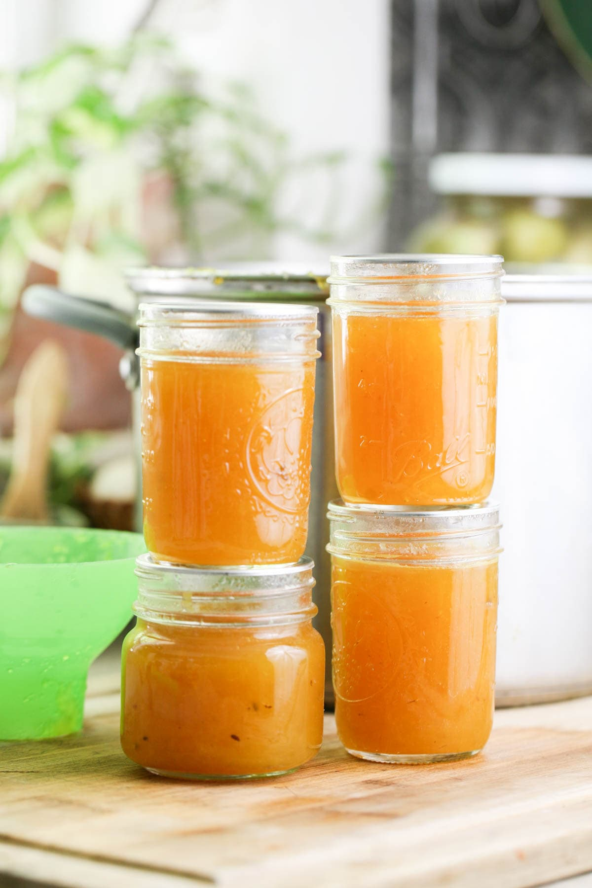 Jars of this easy pineapple jam recipe after canning.