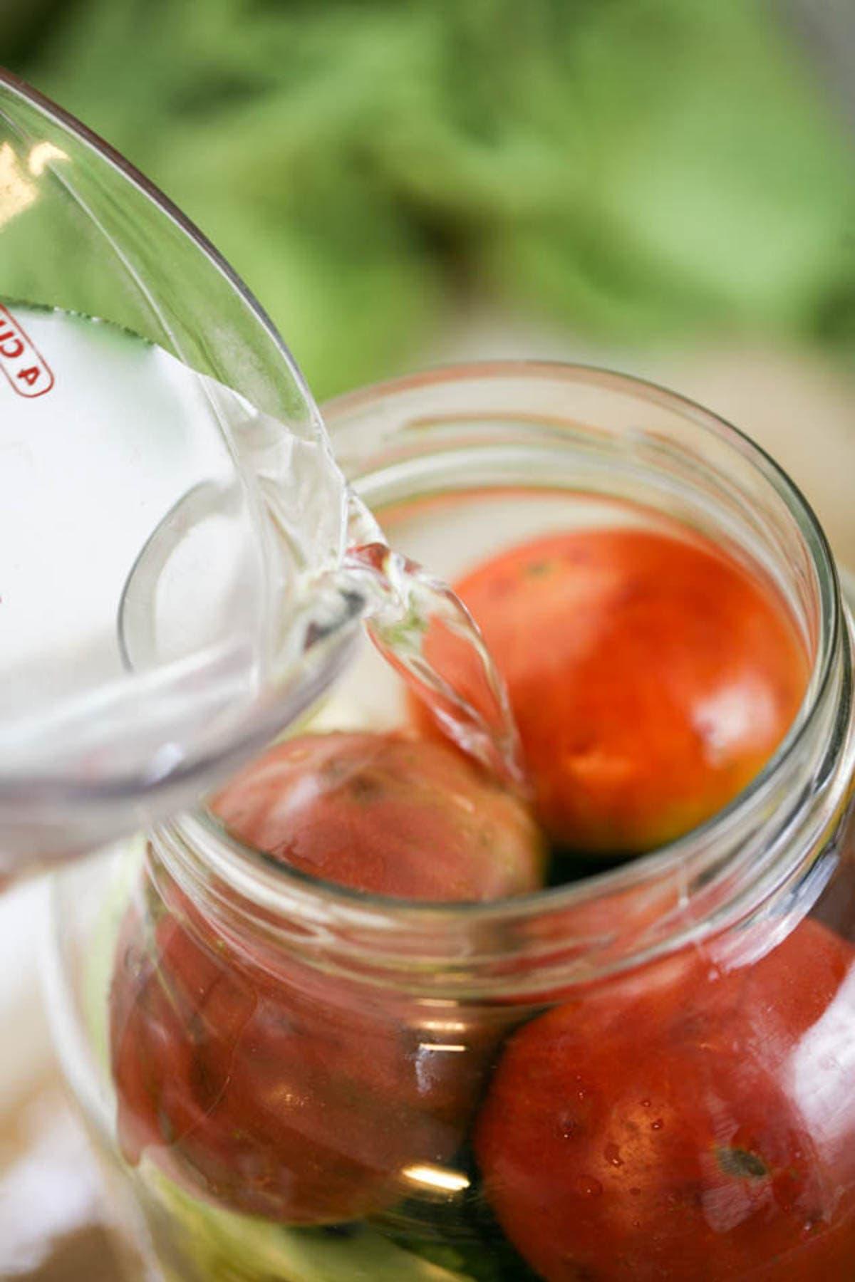 Adding brine to the jar.
