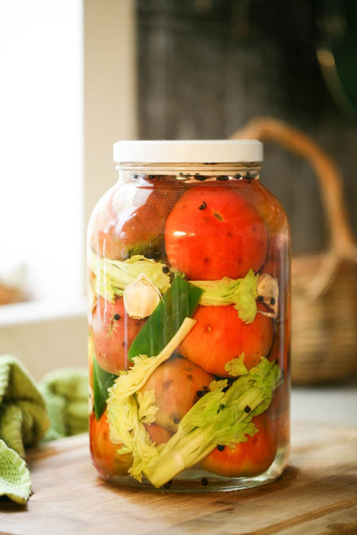 Fermenting tomatoes is a great way to preserve tomatoes without cooking them and it takes minutes to prepare a huge jar. Learn how to ferment tomatoes and use your fermented tomatoes as a side dish, in salads, or add them to sandwiches.