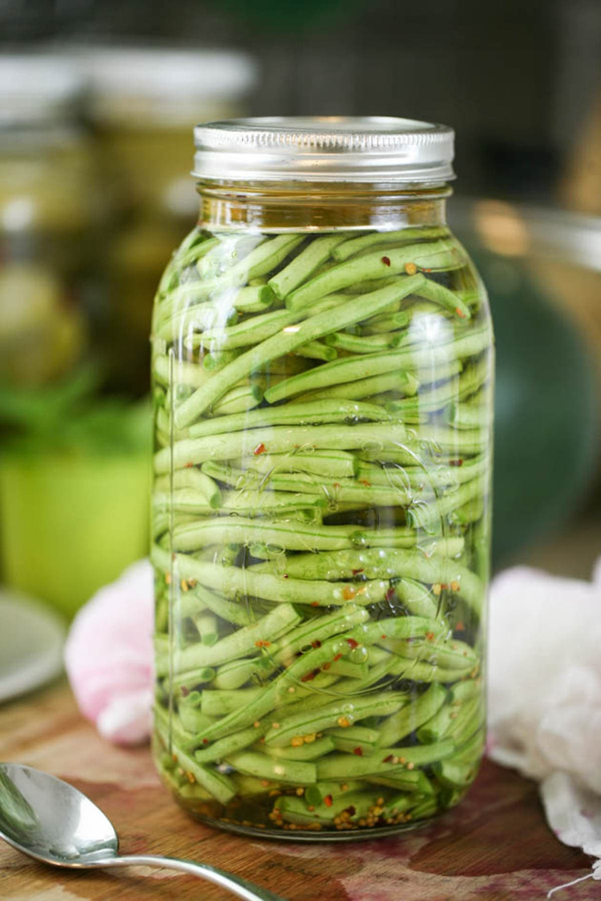 A jar of lacto fermented green beans.