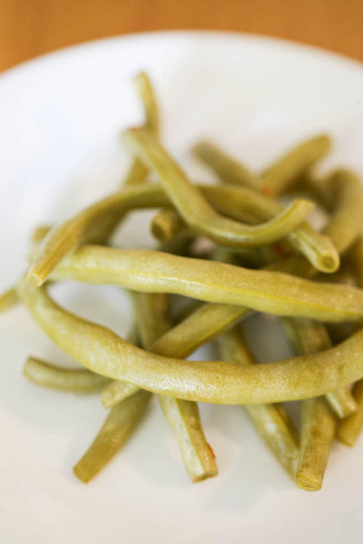 Serving fermented green beans.