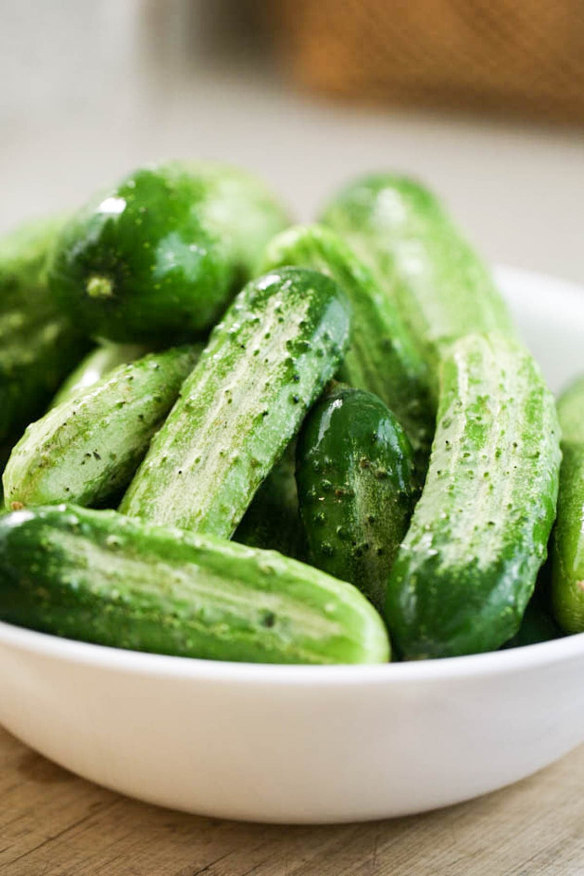 A bowl of pickling cucumbers.