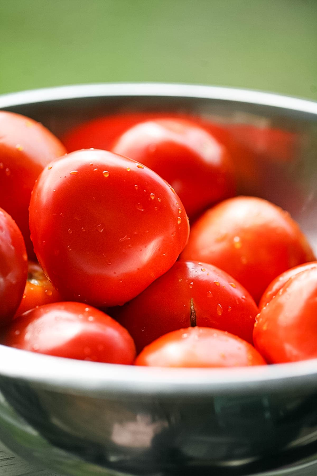 Washing tomatoes before canning sauce.